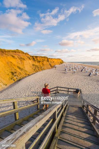 Tourist at Rotes Kliff. Kampen, Sylt island, Germany.