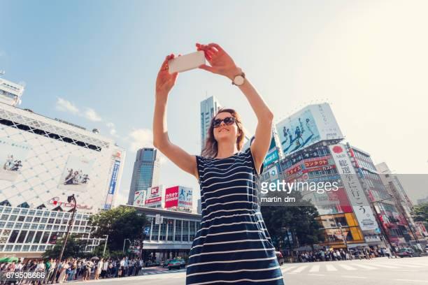 Tourist at Shibuya crossing