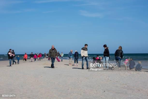 tourist at skagen beach, denmark - jutland stock photos and pictures