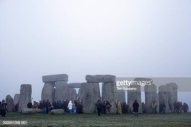 Tourist at Stonehenge in winter