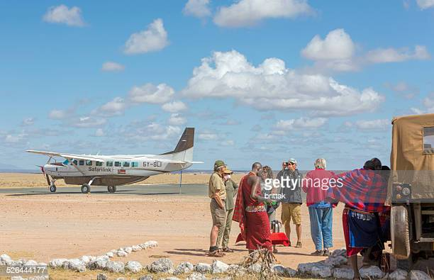 tourist at the airstrip in amboseli national park. - amboseli stock photos and pictures