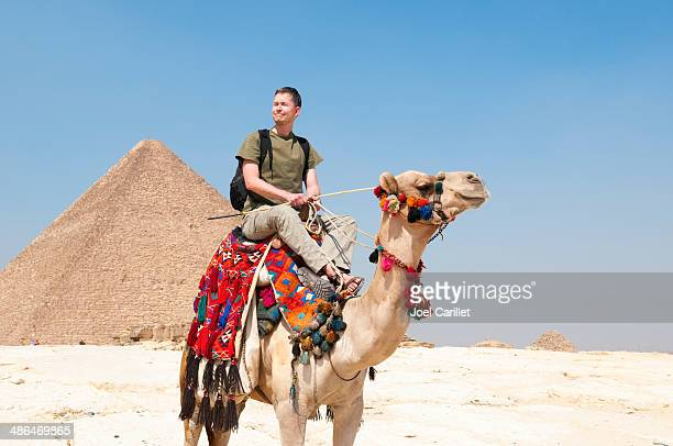 tourist at the giza pyramids - camel stock pictures, royalty-free photos & images