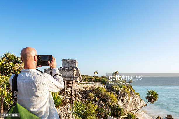 Tourist at the mayan ruins of Tulum, Mexico
