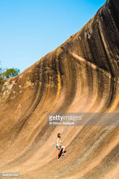 Tourist at the Wave Rock, Western Australia.