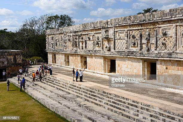 tourist at west building of the nunnery quadrangle, uxmal, mexico-xxxl - ogphoto stock pictures, royalty-free photos & images