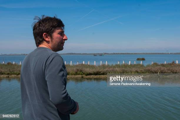 A tourist attend at a tour of fishing tourism organized by Cooperativa San Marco in Burano on April 14 2018 in Venice Italy At the beginning of the...