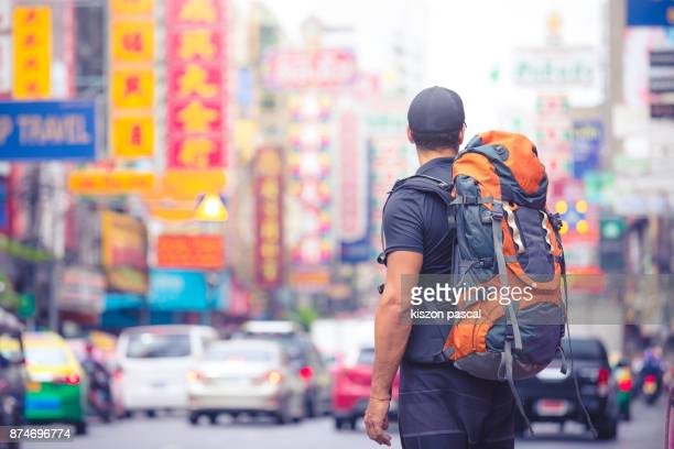 tourist backpacker visiting a city in southeast asia . .