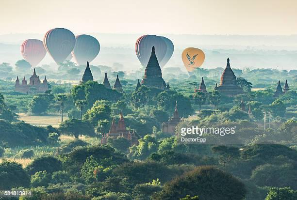 Tourist Balloon flying over pagoda, Bagan, Myanmar