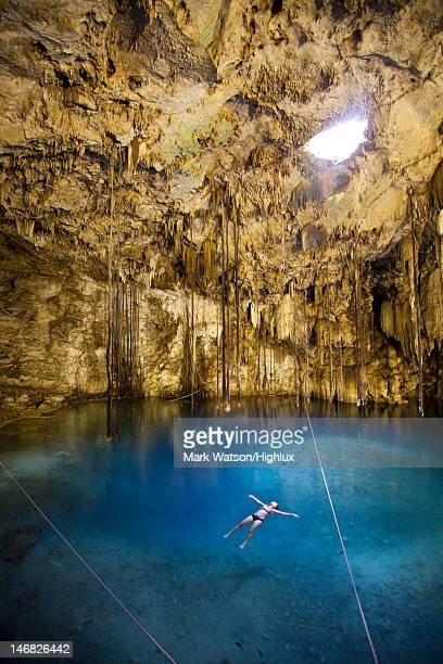 tourist bathing in cenote