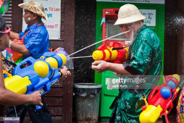 A tourist battles with Thais in a waterfight on Sukhumvit Soi Nana as part of the Songkran water festival on April 14 2013 in Bangkok Thailand The...