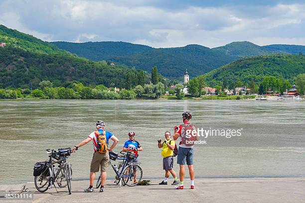 tourist bikers at the danube bend hungary - danube river stock pictures, royalty-free photos & images