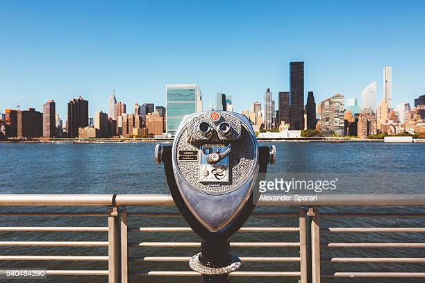 Tourist binoculars at Gantry Plaza State Park overlooking Manhattan skyline, New York City, USA