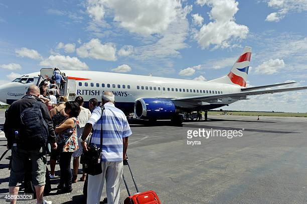 Tourist boarding British Airways Boeing 737-300, Victoria Falls, Simbabwe