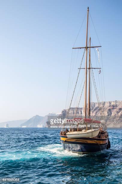 Tourist boat in front of Santorini Island