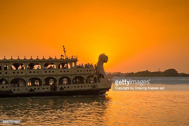 Tourist boat is sailing Hooghly river during sunset in Kolkata, India