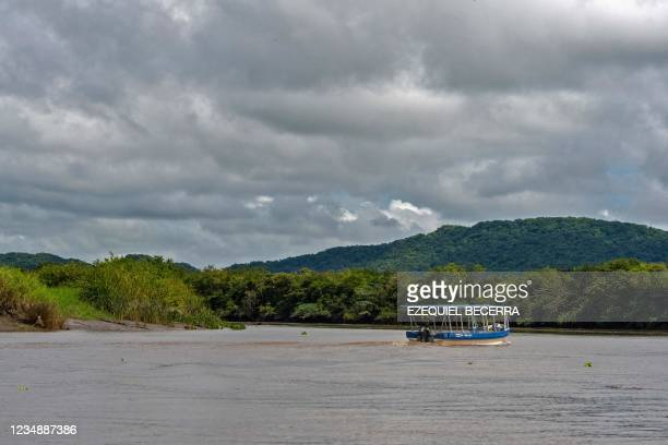Tourist boat is seen in the Tempisque River, in Guanacaste, Costa Rica, on August 26, 2021. - Costa Rica has recovered in the period from January to...