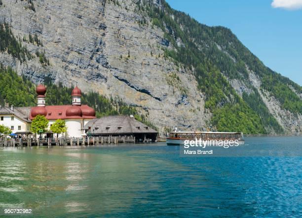 Tourist boat, Koenigssee with pilgrimage church of St. Bartholomew, National Park Berchtesgaden, Berchtesgaden, Upper Bavaria, Bavaria, Germany