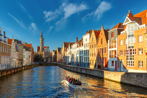 Tourist boat on canal Spiegelrei, Bruges, Belgium 513223402
