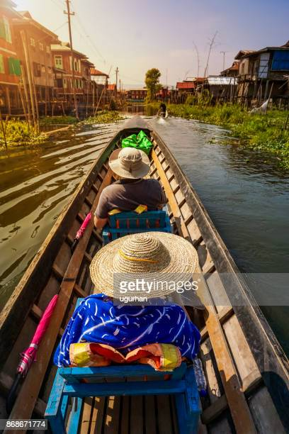 tourist boat on inle lake, myanmar - inle lake stock pictures, royalty-free photos & images