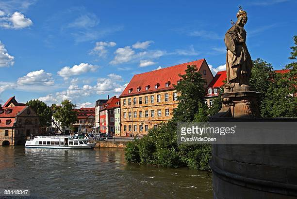Tourist boat on the river Regnitz on June 11 2009 in Bamberg Germany Bamberg is listed as a World Heritage by UNESCO