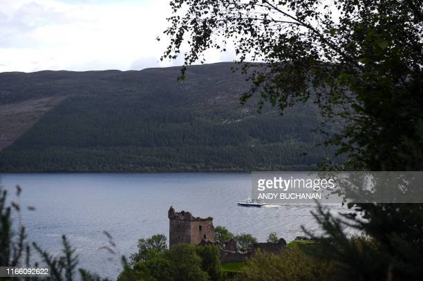 Tourist boat passes Urquhart Castle on Loch Ness in Drumnadrochit, Scotland, on September 5, 2019.