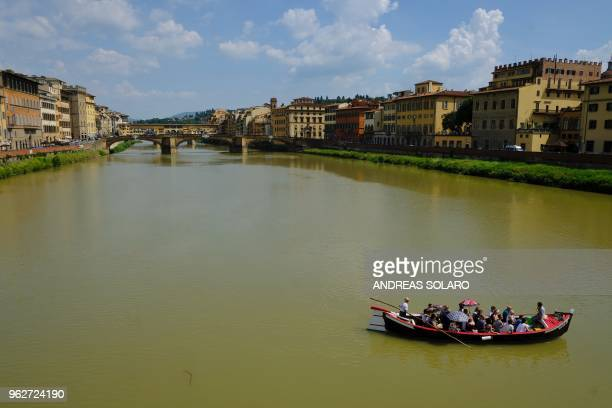 TOPSHOT A tourist boat sailing at Arno river on May 26 2018 in central Florence