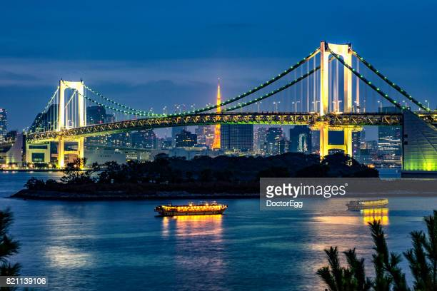 Tourist Boats and Rainbow Bridge with Tokyo Tower Background
