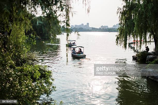 Tourist boats are seen at Daming Lake in Jinan Shandong province on June 18 2016 Jinan is also called the 'Spring City' for its wellknown water...