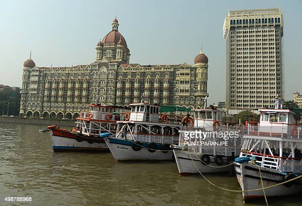 Tourist boats lie anchored near the Taj Mahal Palace hotel one of the 2008 militant attack sites in Mumbai on November 26 2015 A total of 166 people...