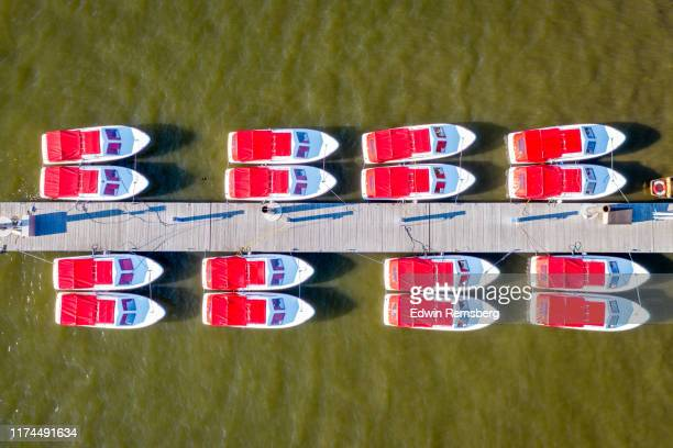 tourist boats - red stock pictures, royalty-free photos & images