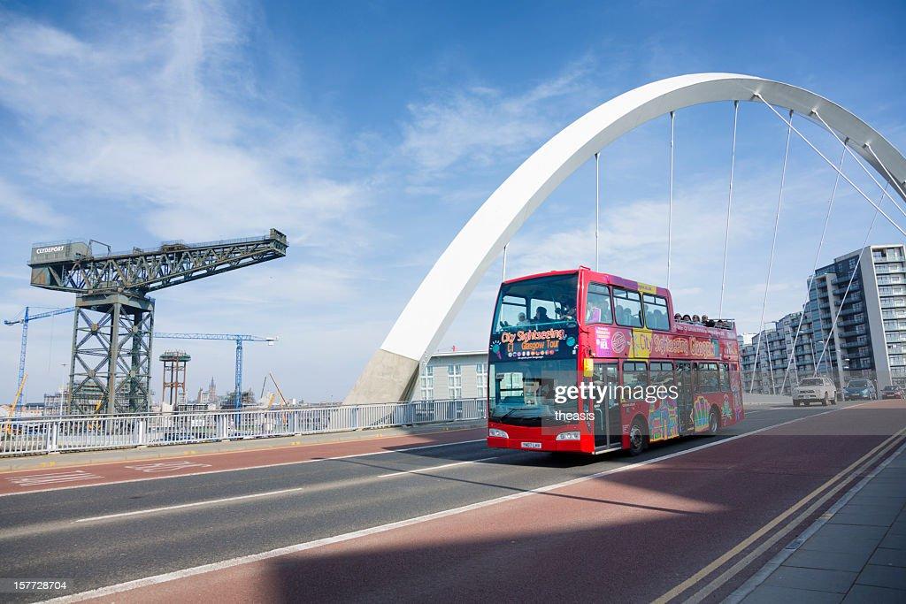Tourist bus crossing the Squinty Bridge, Glasgow : Stock Photo