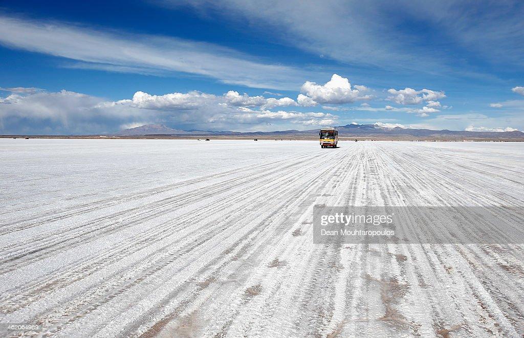 A tourist bus drives on the Salar de Uyuni or Uyuni Salt Flat during Day 7 of the 2014 Dakar Rally on January 11, 2014 in Uyuni, Bolivia.