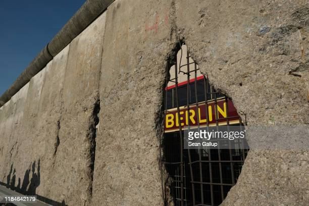 A tourist bus drives past a stillstanding portion of the Berlin Wall in the city center on October 31 2019 in Berlin Germany November 9 will mark the...