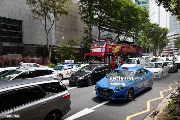 A tourist bus sits among other vehicles in traffic in the central business district of Singapore on Wednesday June 13 2018 Tourism as well as the...