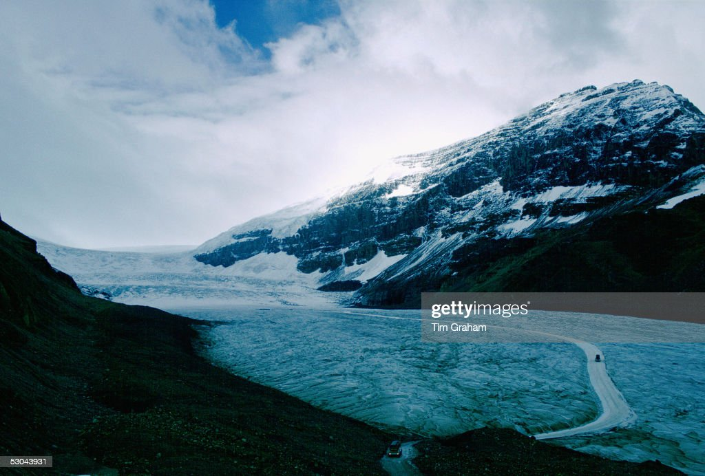 Tourist buses crossing the Athabasca Glacier on the