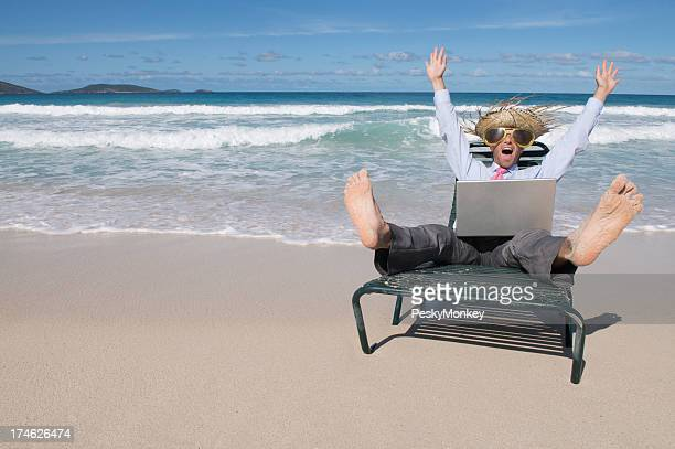 Tourist Businessman Celebrating in Suit with Laptop on Tropical Beach