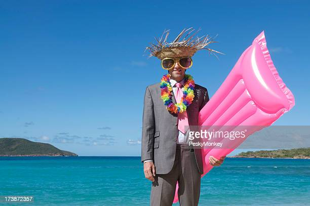 Tourist Businessman Hits the Beach with Bright Pink Raft