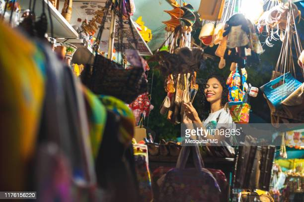 tourist buying at craft fair in olinda, pernambuco - craft product stock pictures, royalty-free photos & images