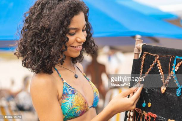 tourist buying costume jewelry at the beach - varadero beach stock pictures, royalty-free photos & images
