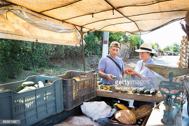 Tourist buying fruit from cart in Trinidad, Cuba