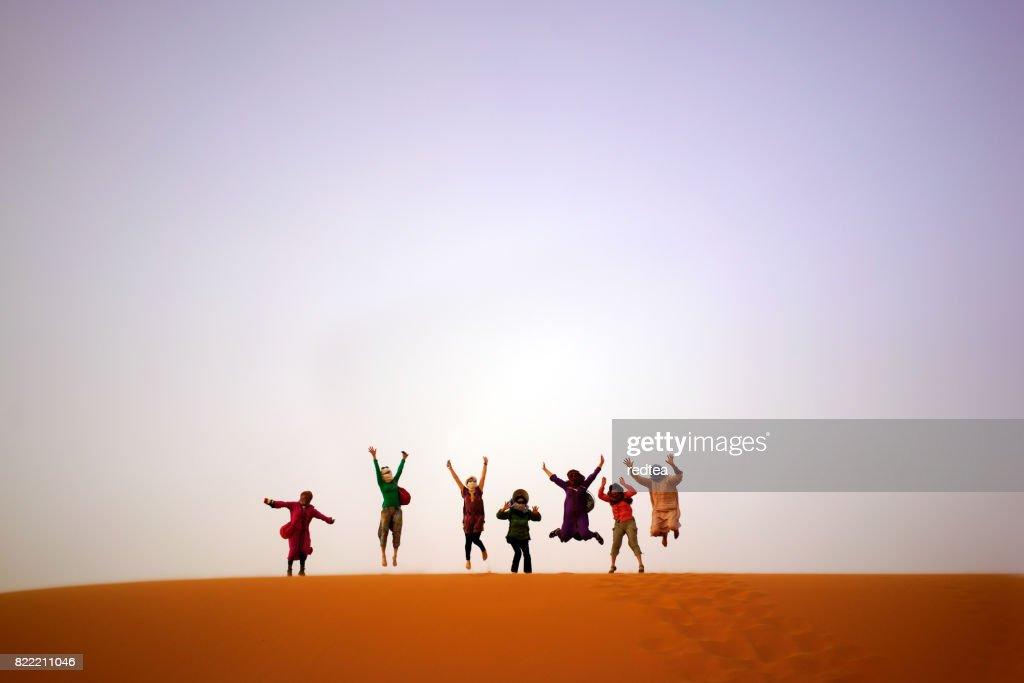 Tourist camel safari in Sahara desert : Stock Photo