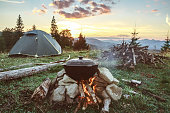 Tourist camp with fire, tent and firewood