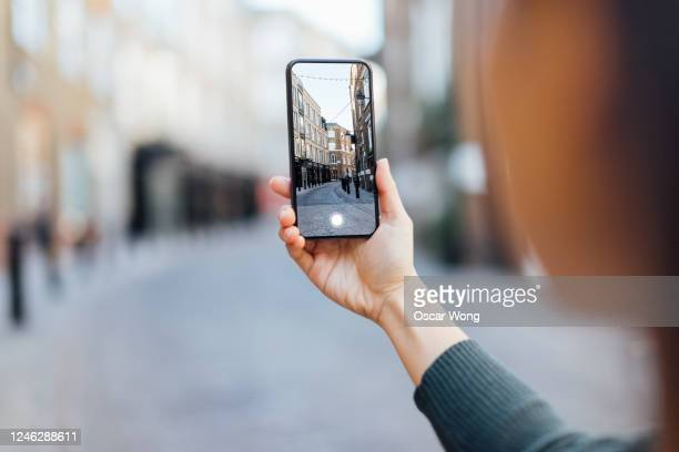 tourist capturing city view in london with smartphone - mobile phone stock pictures, royalty-free photos & images