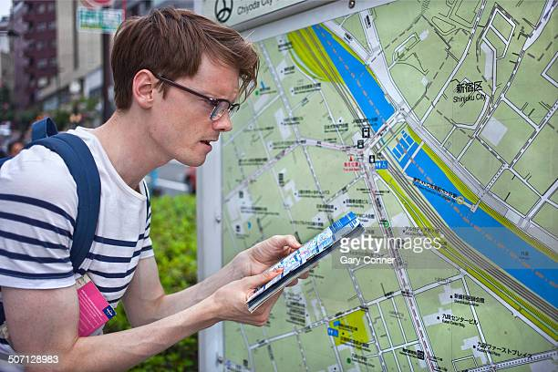 Tourist checks map