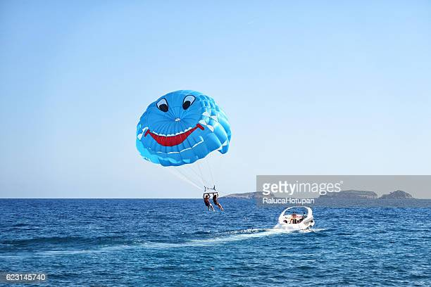 tourist couple doing Parasailing in Tureky