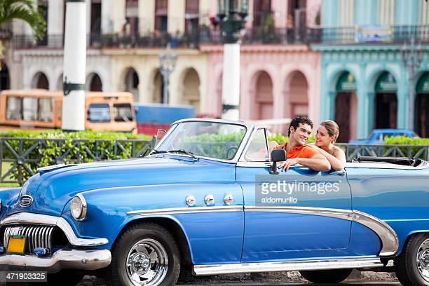 Tourist couple driving a car