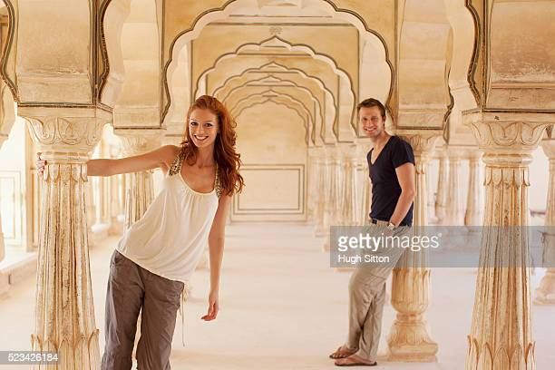 Tourist couple in a room with pillars in the Palace of Amber