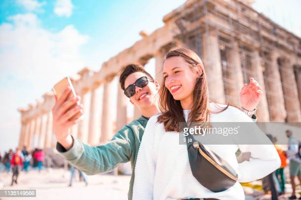 tourist couple in acropolis - athens - athens greece stock pictures, royalty-free photos & images