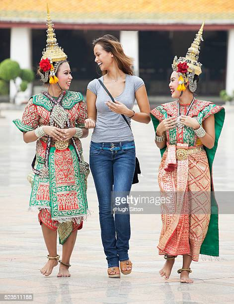 tourist couple in bangkok. thailand. - hugh sitton stock pictures, royalty-free photos & images