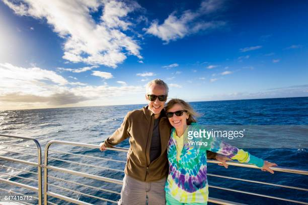 tourist couple in cruise ship boat tour - ponte di una nave foto e immagini stock
